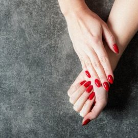young-lady-is-showing-her-red-manicure-nails_80059-197-1.jpg